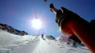 SLO MO POV riding surface ski lift video