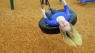 Riding tire swing with head upside down video