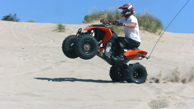 Riding wheelie on a quad, slow motion video
