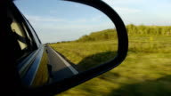 Right car mirror POV. Country side driving video