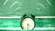 Ringing alarm clock, green blackboard video
