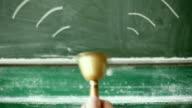 Ringing handbell, green blackboard video