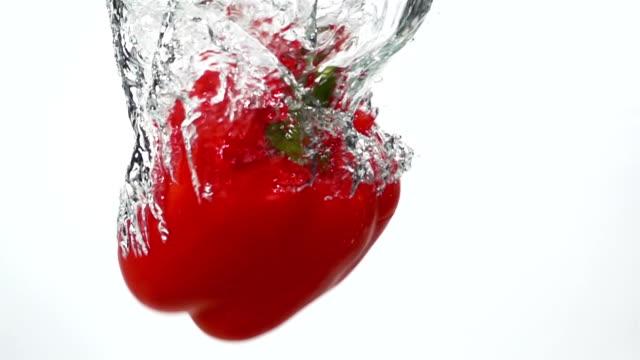 Ripe Red Pepper Falling Through Water. video