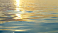 Rippling water with sunset reflection video