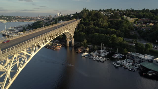 Rising Aerial of Beautiful City Bridge with People Driving and Boating on Sunny Day video