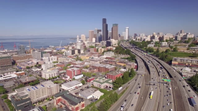 Rising Aerial of Downtown Seattle Washington with Interstate Freeway and Skyscraper Buildings in Beautiful Cityscape video
