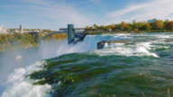 River and Niagara Falls. The powerful flow of water in the foreground . One of the most popular interest of New York - Niagara Falls video