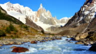 River below mountain peaks of Cerro Torre, Patagonia, Argentina video