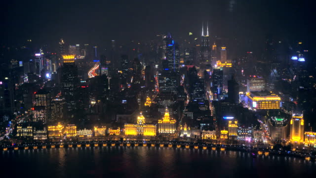 River Boats on the Huangpu River and as Background the Skyline of the Northern Part of Puxi at night. video