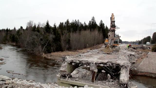 River flowing under the damaged bridge video