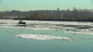 River Ice Tugboat and Logboom. 4K UHD video
