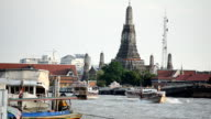 River in Thailand and its transportation in front of Wat Arun (Wat Arun Ratchawararam Ratchawaramahawihan). A Buddhist temple on the Thonburi west bank of the Chao Phraya River in Bangkok, Thailand, Footage video