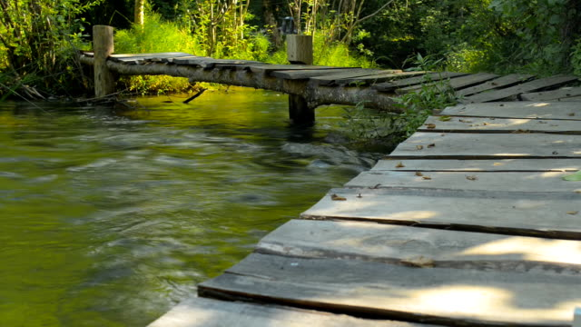 River, mountains, nature bridge crossing.(Time Lapse) video