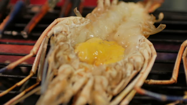 River Prawn grilled on fire , panning movement , 4k(UHD) video