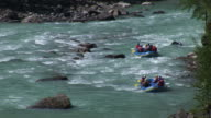 River rafting down rapids of a glacial river. video