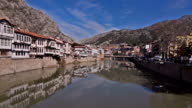 River scene of old traditional Ottoman houses in Amasya, Turkey video
