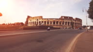 Road and traffic the Coliseum, in Rome video