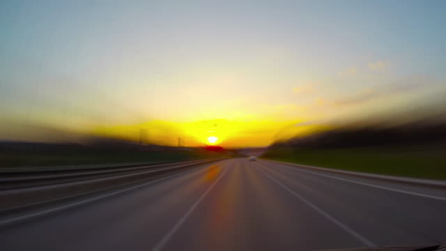 Road at sunset, 4k time-lapse video