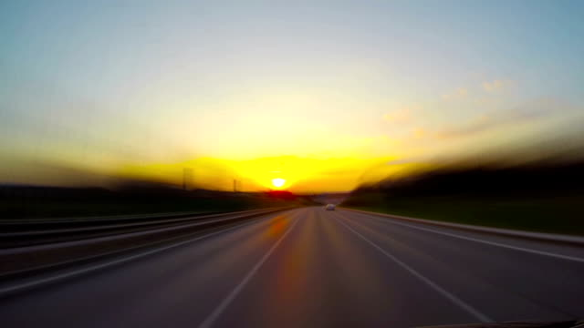 road at sunset, time-lapse video