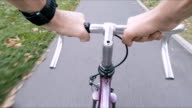 Road bike cycling on city street, personal perspective video