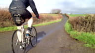Road bike racer goes past video
