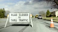 Road closed to thru traffic sign video