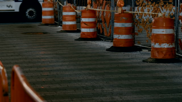 Road construction. Traffic cones on pavement video