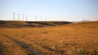 Road leading to wind turbines video