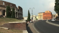Road next to the Colosseum, Rome; tourists and traffic, timelapse video