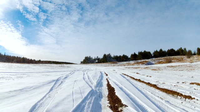 Road on the mountain plateau in winter, Go Pro video