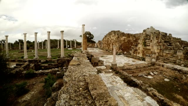 Road paved with marble tiles between Roman Agora and baths ancient town Salamis east Cyprus Famagusta video