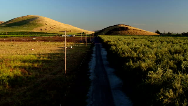 RoadFarm With Mountains Sun Set Wild Life Animals Aerial View Wide Angle video