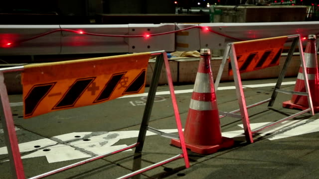 Roadside Construction: Traffic Cones exhibited in the roadway at night in Japan. video