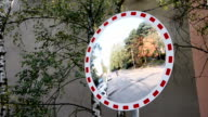 Roadside mirror and cars driving video