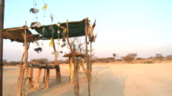 Roadside stall selling crafts on Namibian dirt road, late afternoon video