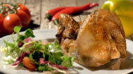 roast chicken with salad on white plate rotating video