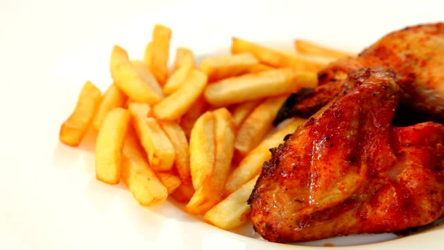 Roasted chicken wings and chips dolly shot video