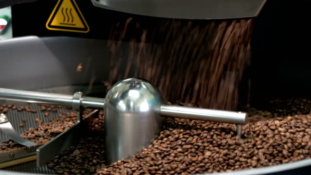 roasted coffee beans in a coffee roaster video