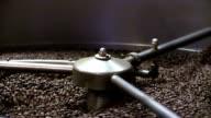 Roasted coffee beans in coffee roaster video