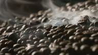 Roasted coffee beans with a smoke video