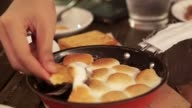 Roasted marshmallow on pan plate. Stuffed chocolate inside serving with biscuit video