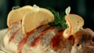 Roasted meat garnished with greens and vegetables video