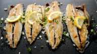 Roasting Fish on a Pan with Condiments and Lemon video
