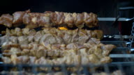 Roasting of pork meat on the fire coals video