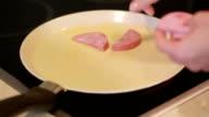 roasting slices of sausage. preparing breakfast. burning meat video