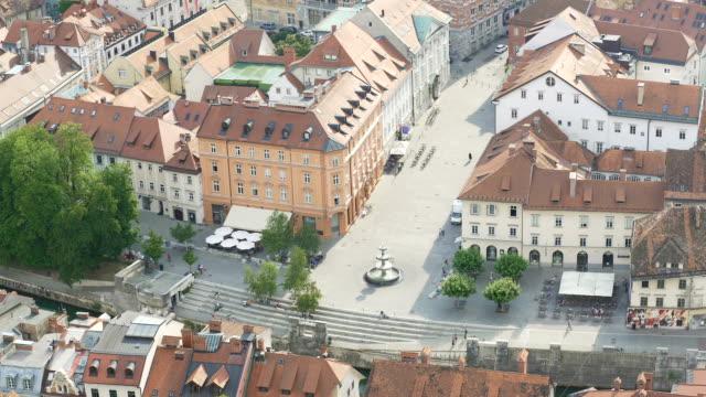 Robba Fountain in Ljubljana center, Slovenian tourist attraction, aerial view video