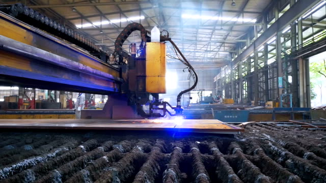 Robot arm assembly line welding or cutting iron plate, real time. video