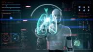 Robot touching digital screen, Human lungs, Pulmonary Diagnostics. X-ray image. video