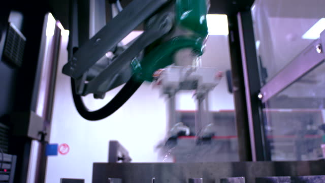 Robotic arm factory. Robot arm at packaging line. Automated production equipment video
