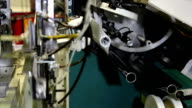 Robotic Arm Working on Factory Assembly Line - Pantyhose Manufacturing video